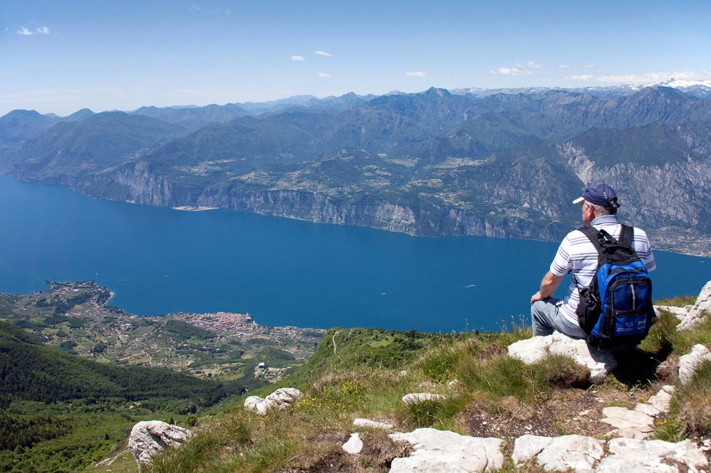 Stock Photo: 1848-688249 Hikers on Mt. Monte Baldo, Monte Baldo massif, view on Lake Garda, Malcesine, Verona province, Veneto, Italy, Europe