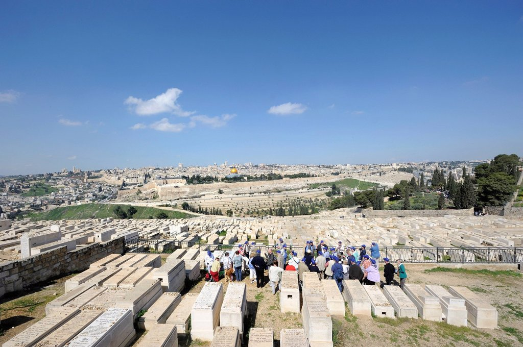 Group of tourists on a guided tour through the Jewish cemetery on the Mount of Olives overlooking the old town of Jerusalem, Israel, Middle East : Stock Photo