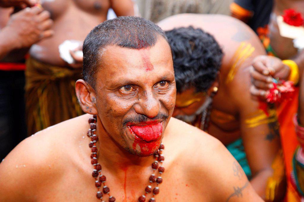 Stock Photo: 1848-689329 Pilgrim with spiritual tongue piercing, Hindu festival Thaipusam, Batu Caves limestone caves and temples, Kuala Lumpur, Malaysia, Southeast Asia, Asia