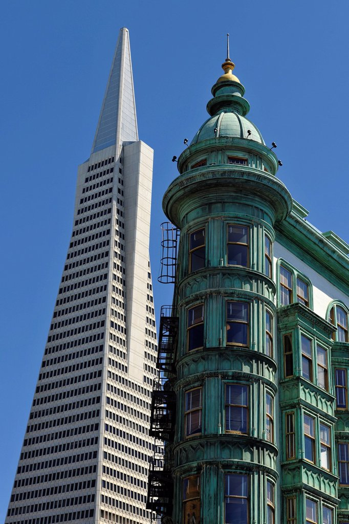 Transamerica Pyramid, skyscraper, behind the Columbus Tower, also known as Sentinel Building, Financial District, San Francisco, California, United States of America, USA, PublicGround : Stock Photo