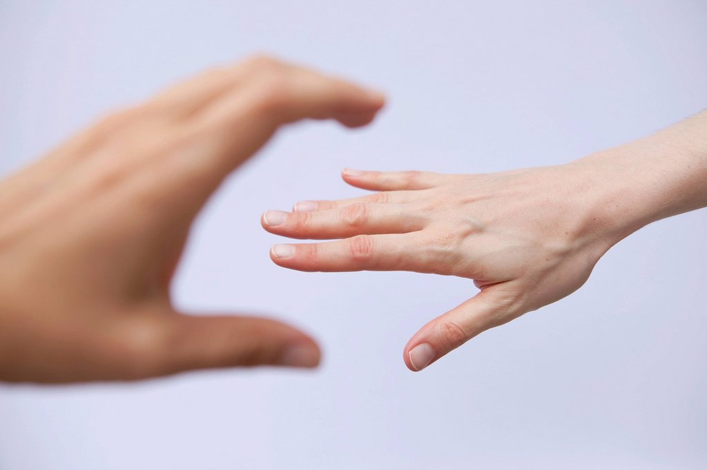 Stock Photo: 1848-691625 Hand reaching for another hand