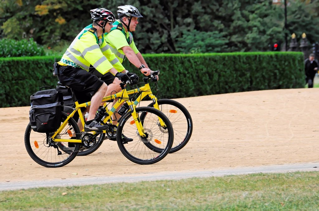 Stock Photo: 1848-692201 Two police officers on bicycles, bicycle patrol, in Hyde Park, London, England, United Kingdom, Europe