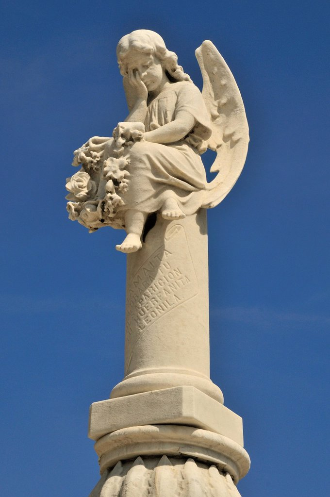 Stock Photo: 1848-692518 Statue of an angel on one of the monumental tombs, Colon Cemetery, Cementerio Cristóbal Colón, named after Christopher Columbus, Havana, Cuba, Caribbean
