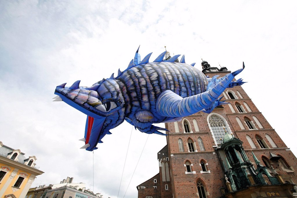 Stock Photo: 1848-692791 Flying dragon figure during a parade in front of a church, market square, Krakow, Poland, Europe
