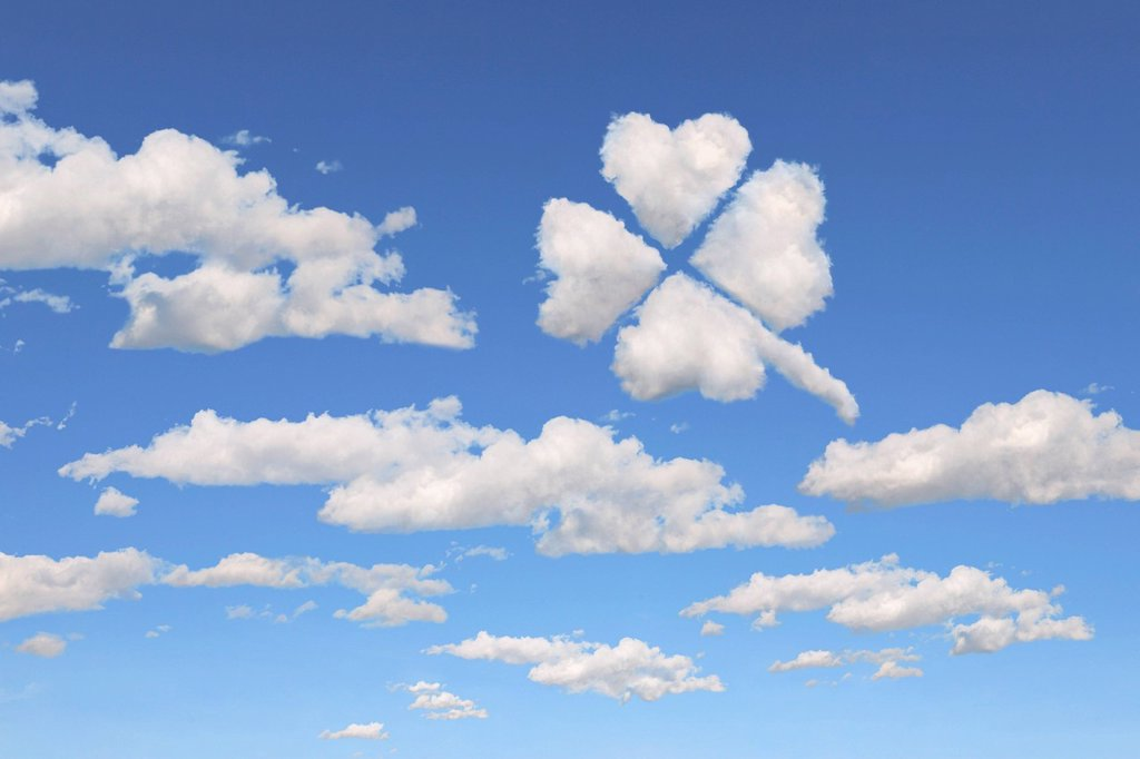 Stock Photo: 1848-693352 Cloud formations in the shape of a four_leafed clover, illustration
