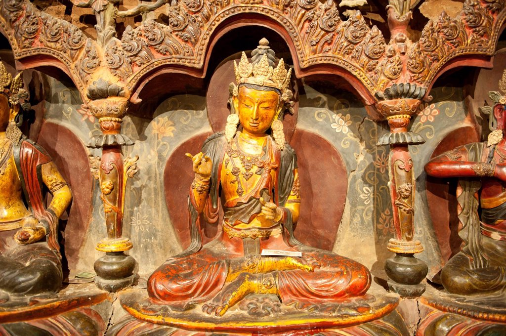 Stock Photo: 1848-693590 Tibetan Buddhism, Newari_style sculptures, colourfully painted statues made of wood and clay, yellow Buddha statue, Palcho Monastery, also known as Pelkor Chode Monastery, Gyantse, Himalaya Range, Tibet Autonomous Region, People´s Republic of China, Asia