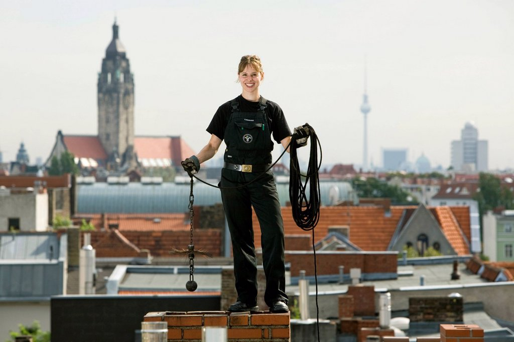Master chimney sweep, Steffi Marienfeld, working on the roof of a building in Charlottenburg, Berlin, Germany, Europe : Stock Photo