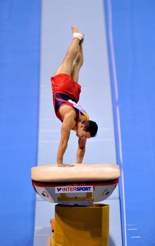 Stock Photo: 1848-697877 Rafael Martinez, ESP, during vault, EnBW Gymnastics World Cup, 11 to 13 Nov 2011, 29th DTB Cup, Porsche_Arena, Stuttgart, Baden_Wuerttemberg, Germany, Europe