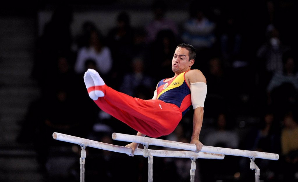 Stock Photo: 1848-697878 Rafael Martinez, ESP, performing on parallel bars, EnBW Gymnastics World Cup, 11 to 13 Nov 2011, 29th DTB Cup, Porsche_Arena, Stuttgart, Baden_Wuerttemberg, Germany, Europe