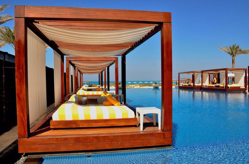 Stock Photo: 1848-698364 Swimming pool of the Monte Carlo Beach Club on Saadiyat Island, Abu Dhabi, United Arab Emirates, Arabian Peninsula, Asia