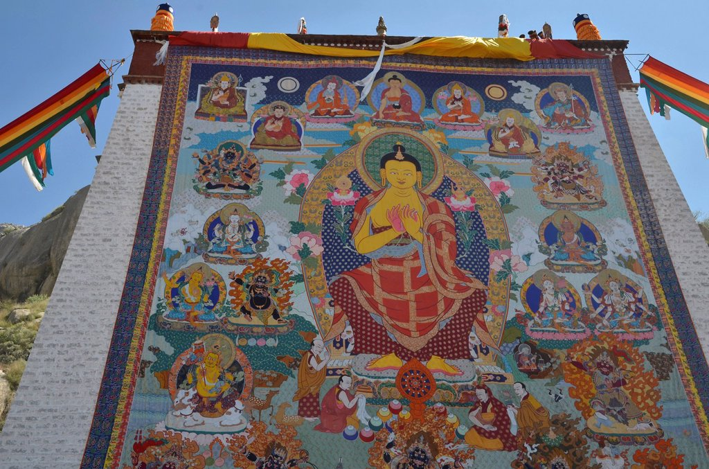Stock Photo: 1848-699183 Tibetan Buddhism, religious fabric, large Thangka of Sera, a giant Buddha image is unfurled during the Shoton, Sho Dun or Yoghurt Festival, Sera Monastery, Lhasa, Tibet, China, Asia