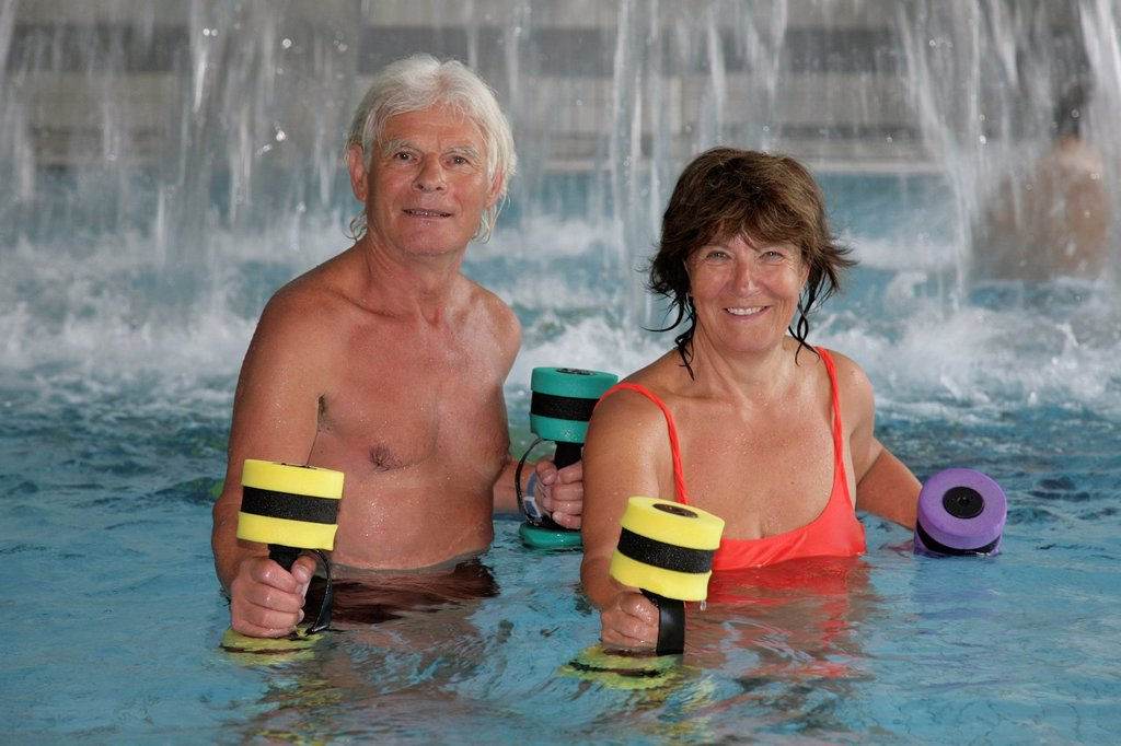 Senior couple doing senior sports in the Roland Matthes swimming hall in Erfurt, Thuringia, Germany, Europe : Stock Photo