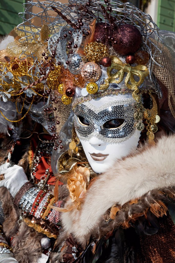 Stock Photo: 1848-701249 Masked woman with Christmas decorations on her head at the carnival in Venice, Veneto, Italy, Europe