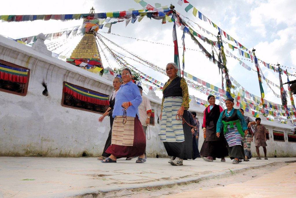 Pilgrims walking around stupa of Boudhanath, Kathmandu, Nepal, Asia : Stock Photo