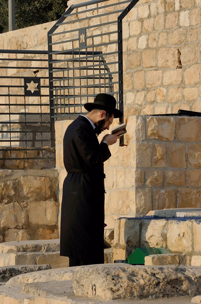 Stock Photo: 1848-703083 Orthodox Jew during evening prayer in the Jewish cemetery on the Mount of Olives, Jerusalem, Israel, Middle East