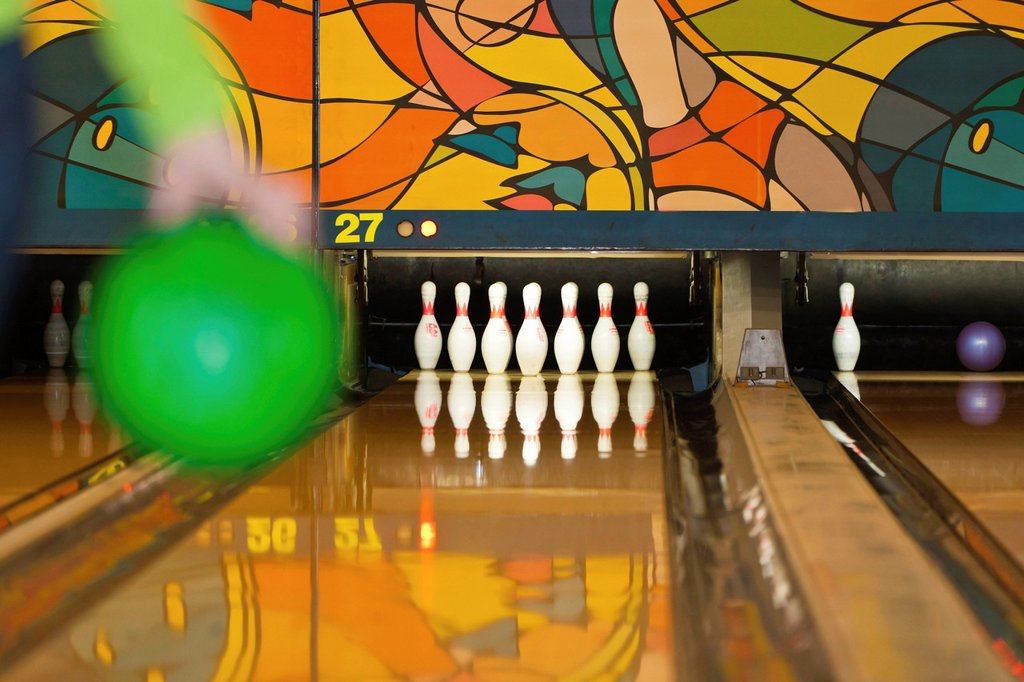 Stock Photo: 1848-703206 Bowling player about to bowl a bowling ball, bowling centre, Germany, Europe
