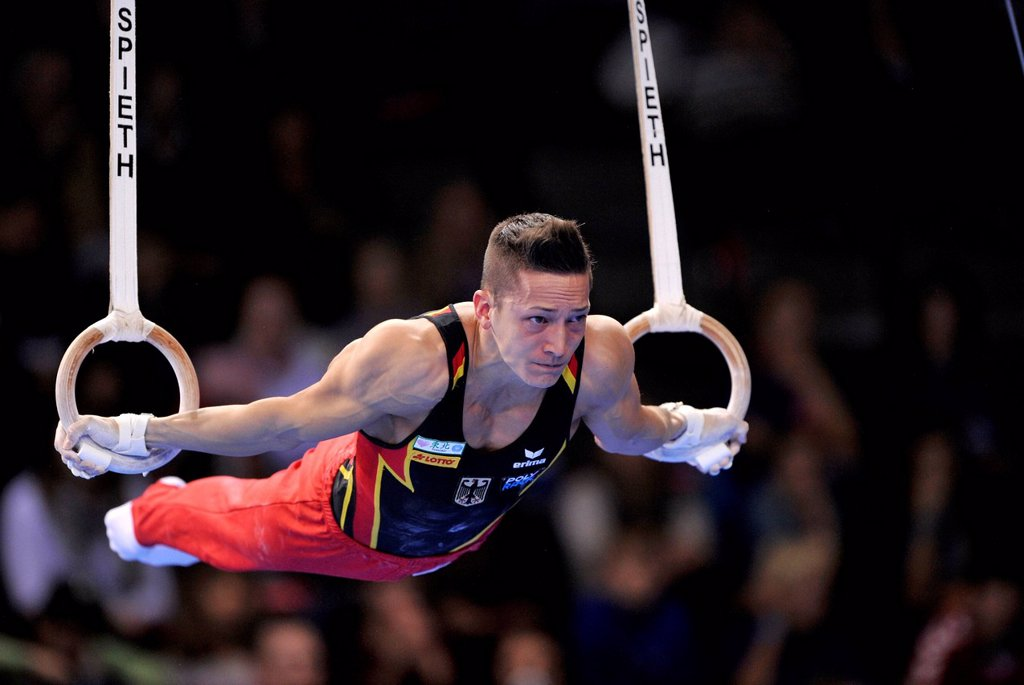 Marcel Nguyen, GER, performing on still rings, EnBW Gymnastics World Cup, 11 to 13 Nov 2011, 29th DTB Cup, Porsche_Arena, Stuttgart, Baden_Wuerttemberg, Germany, Europe : Stock Photo