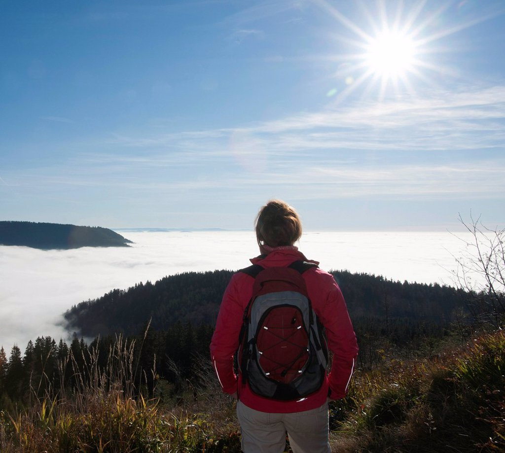 Stock Photo: 1848-703270 Woman hiker looking at a fog shrouded valley, Black Forest, Baden_Wuerttemberg, Germany, Europe
