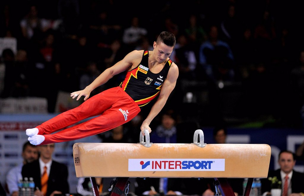 Stock Photo: 1848-703691 Marcel Nguyen, GER, performing on pommel horse, EnBW Gymnastics World Cup, 11 to 13 Nov 2011, 29th DTB Cup, Porsche_Arena, Stuttgart, Baden_Wuerttemberg, Germany, Europe