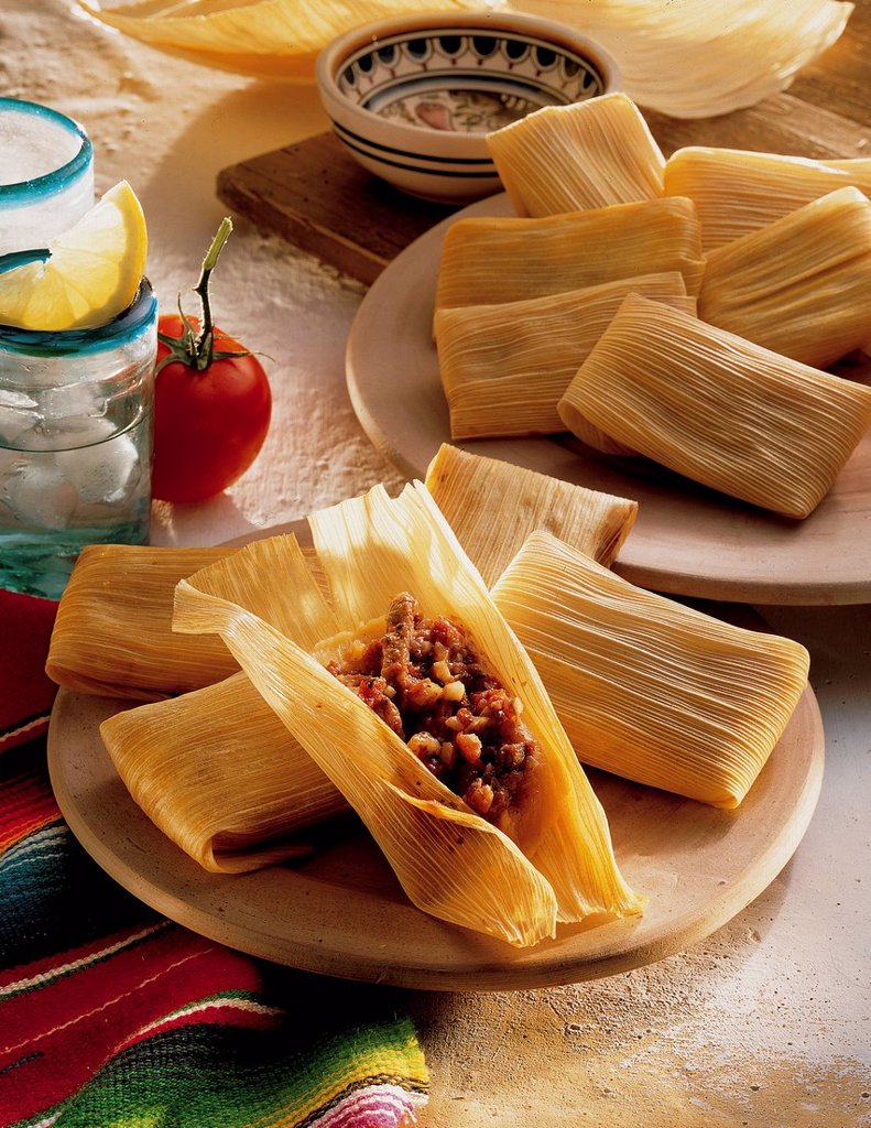 Tamales, sweetcorn parcels, dough of sweetcorn flower with spicy chopped pork, Mexico, recipe available for a fee : Stock Photo