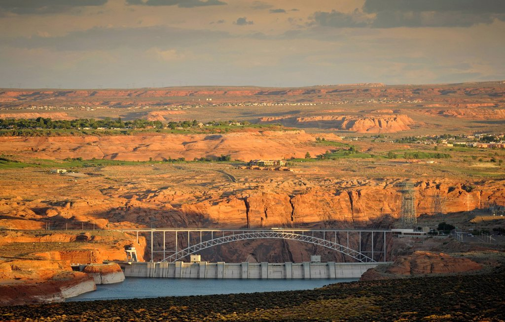 View from Wahweap View Overlook at Glen Canyon Dam in the evening light, behind Glen Canyon Bridge with Highway 89, Page, Glen Canyon National Recreation Area, Arizona, United States of America, PublicGround : Stock Photo