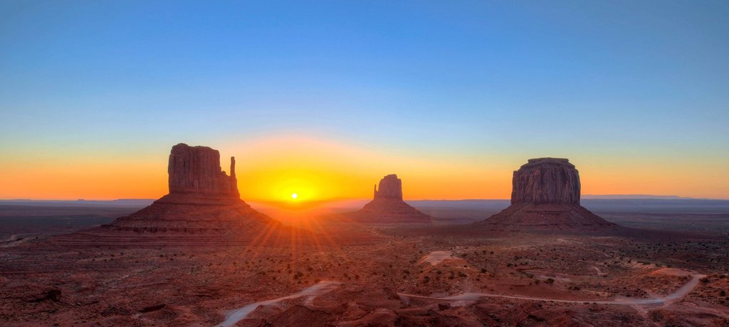 Panoramic view, sunrise at the mesas of West Mitten Butte, East Mitten Butte, Merrick Butte, Scenic Drive, Monument Valley, Navajo Tribal Park, Navajo Nation Reservation, Arizona, Utah, United States of America, USA : Stock Photo