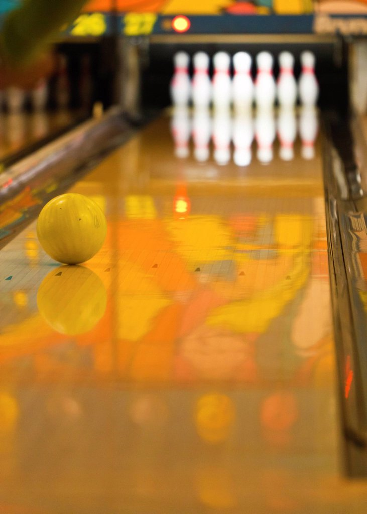 Bowling ball rolling towards the bowling pins, bowling centre, Germany, Europe : Stock Photo