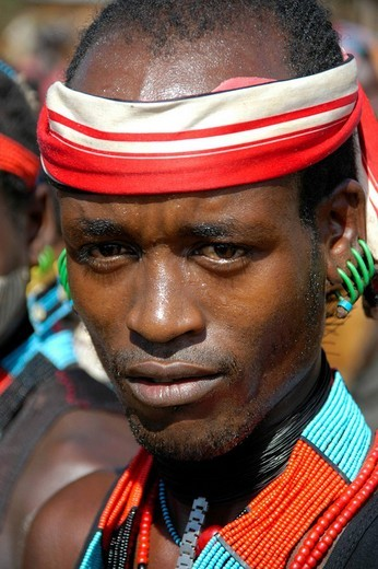 Man wearing a bandanna and a colorful necklace, portrait, at the markets in Dimeka, Ethiopia, Africa : Stock Photo