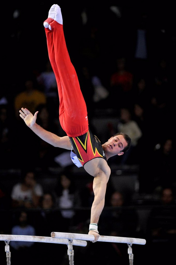 Sebastian Krimmer, GER, performing on parallel bars, EnBW Gymnastics World Cup, 11 to 13 Nov 2011, 29th DTB Cup, Porsche_Arena, Stuttgart, Baden_Wuerttemberg, Germany, Europe : Stock Photo