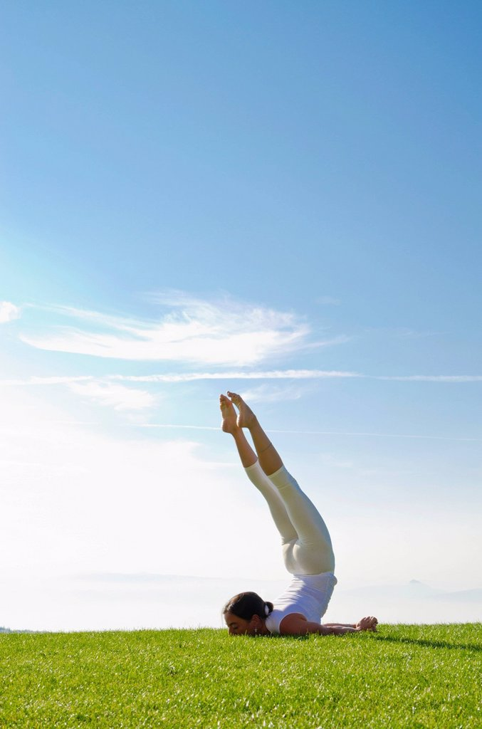 Stock Photo: 1848-705960 Young woman practising Hatha yoga outdoors, showing the pose shalabhasana, locust, Nove Mesto, Okres Teplice, Czech Republic, Europe