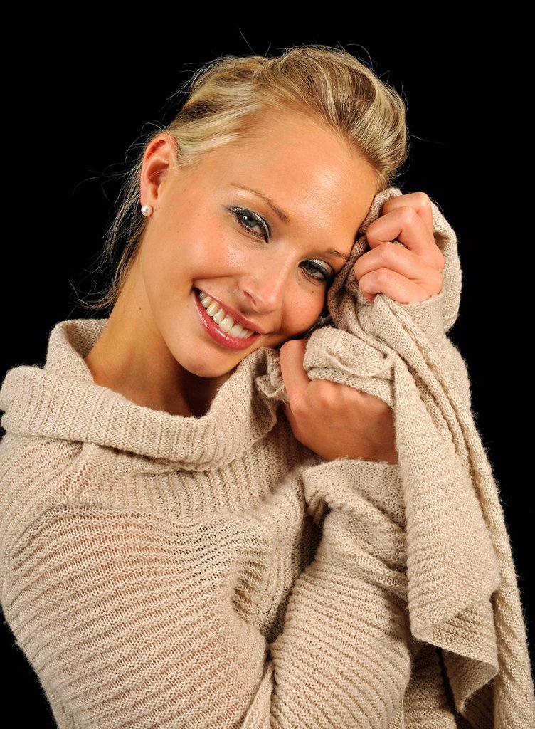 Young woman wearing a sweater, cozy : Stock Photo