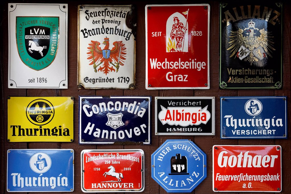 Stock Photo: 1848-706521 Collection of old tin signs of German and Austrian insurance companies