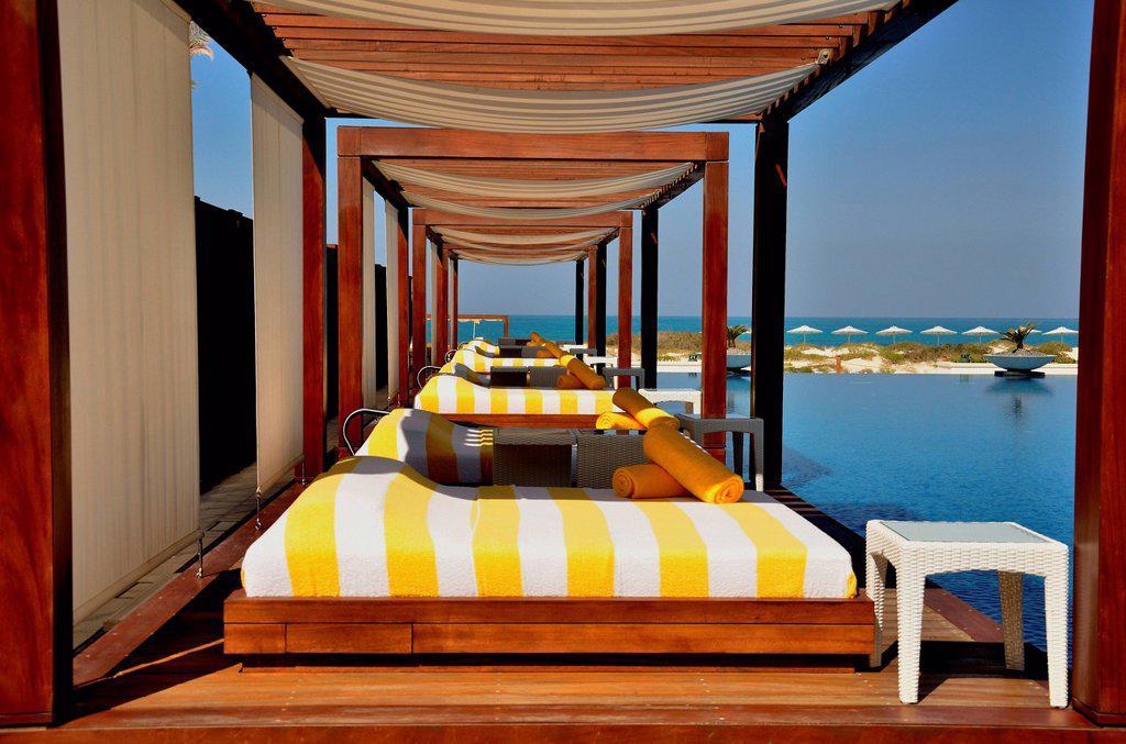 Swimming pool of the Monte Carlo Beach Club on Saadiyat Island, Abu Dhabi, United Arab Emirates, Arabian Peninsula, Asia : Stock Photo