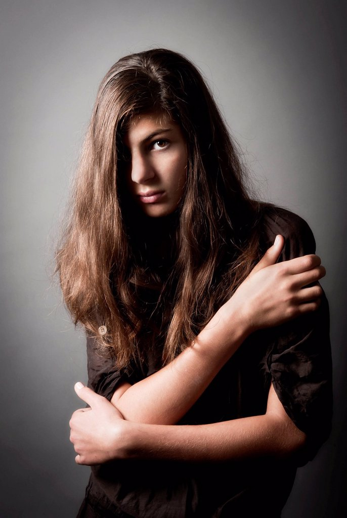 Pensive girl, aged 13, with long hair, portrait : Stock Photo