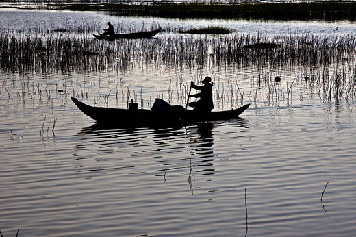 Stock Photo: 1848-70779 Boats on Lake Tonle Sap at dusk, Cambodia, south_east Asia