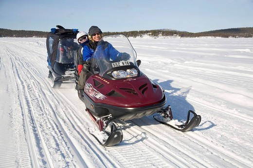 Stock Photo: 1848-70824 Woman, in her forties, and a girl, 6, on a snowmobile tour in Kiruna, Lappland, North Sweden, Sweden