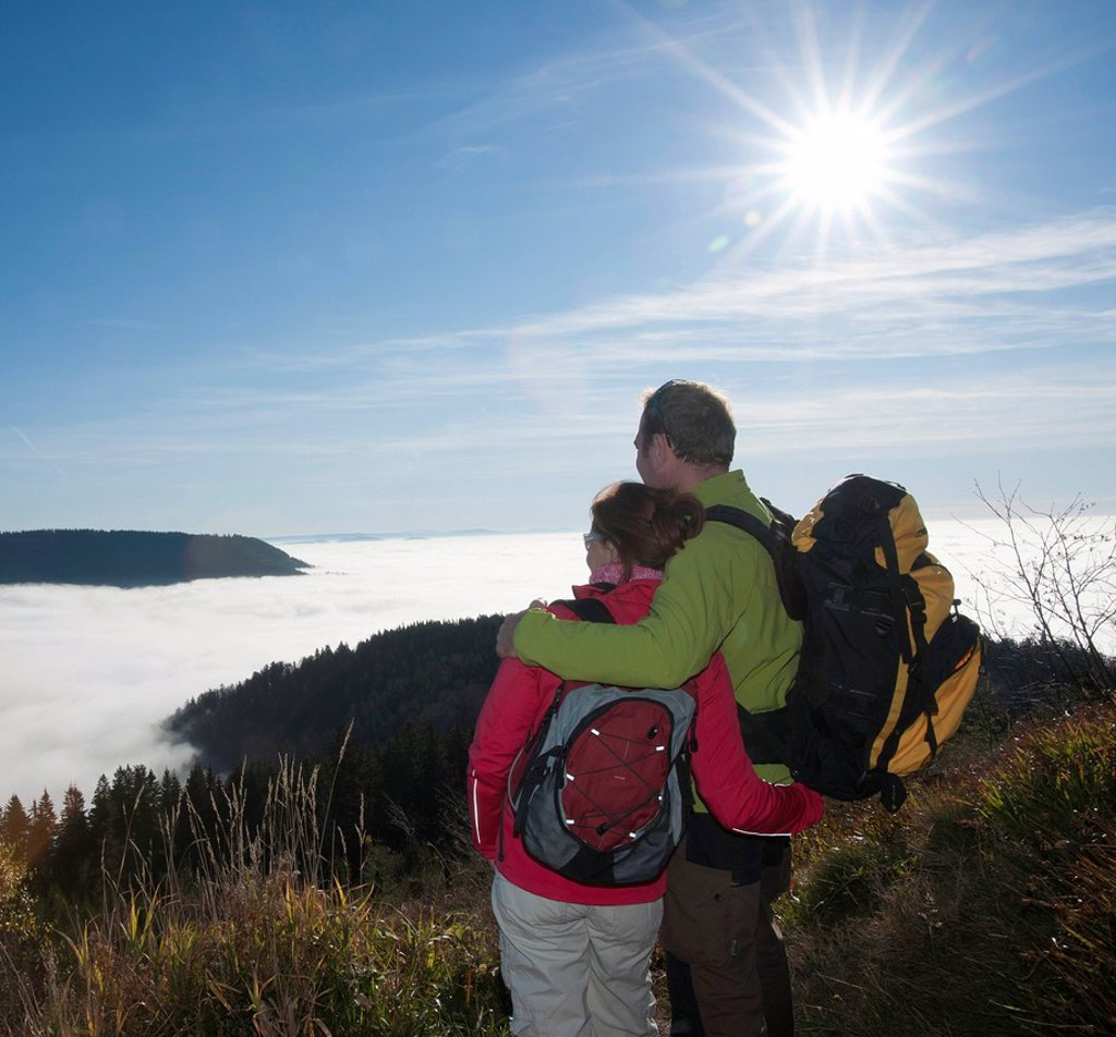Stock Photo: 1848-708322 Couple on a hiking trip looking at a fog shrouded valley, Black Forest, Baden_Wuerttemberg, Germany, Europe