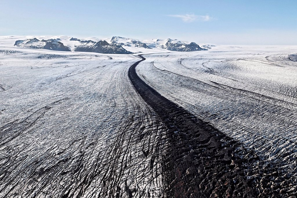 Stock Photo: 1848-708557 Aerial view, lines and structures consisting of ice, snow, volcanic ash and black lava on the south side of Vatnajoekull glacier, Iceland, Europe