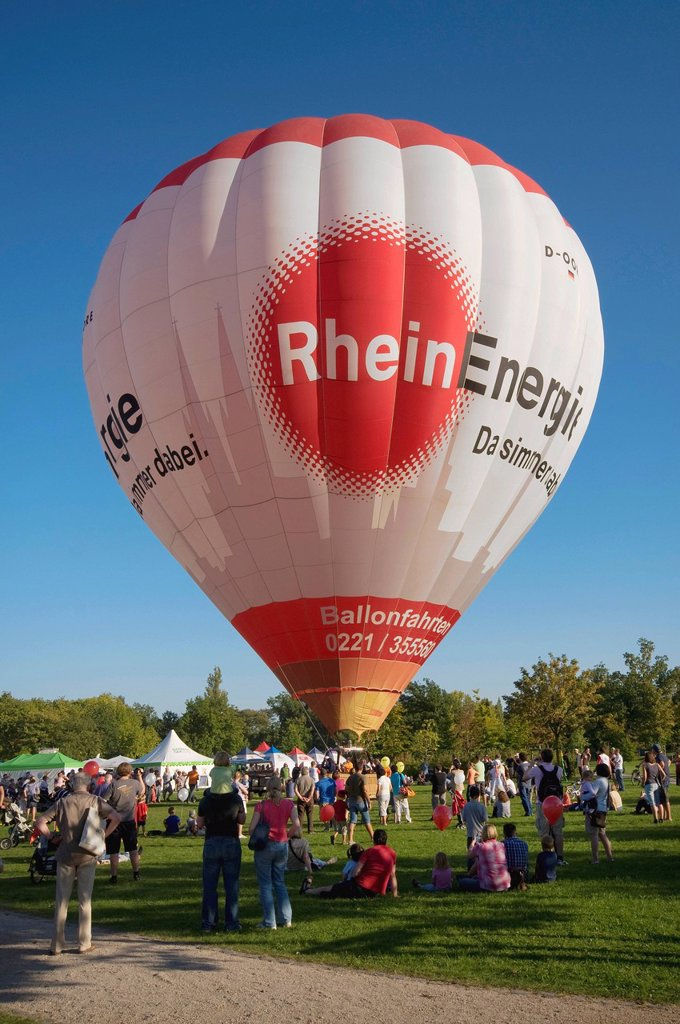 Moored balloon with a Rheinenergie logo before take_off, spectators, Rheinaue Bonn public festival, North Rhine_Westphalia, Germany, Europe : Stock Photo