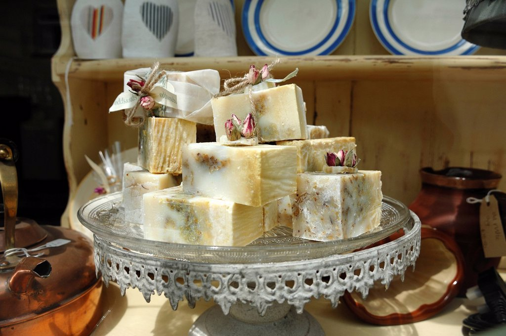 Stock Photo: 1848-709493 Scented soaps on a glass plate in a shop window, Tavistock, Devon, England, United Kingdom, Europe