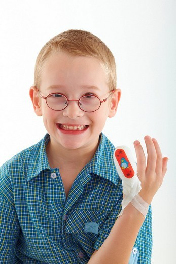 Child has a bandage on his little finger : Stock Photo