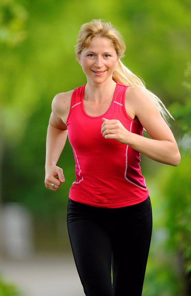 Stock Photo: 1848-70984 Young woman jogging