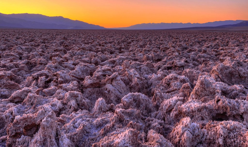 Spectacular lighting after sunset, salt crust on the Devil´s Golf Course, Panamint Range, Black Mountains, Death Valley National Park, Mojave Desert, California, United States of America, USA : Stock Photo