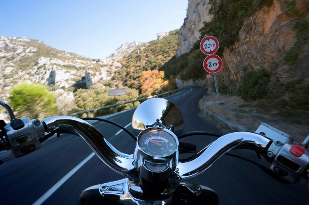 Stock Photo: 1848-710395 Motor scooter being driven in the Gorges de Galamus, a narrow passage between the departments Aude and Pyrénées_Orientales, Northern Catalonia, France, Europe, PublicGround