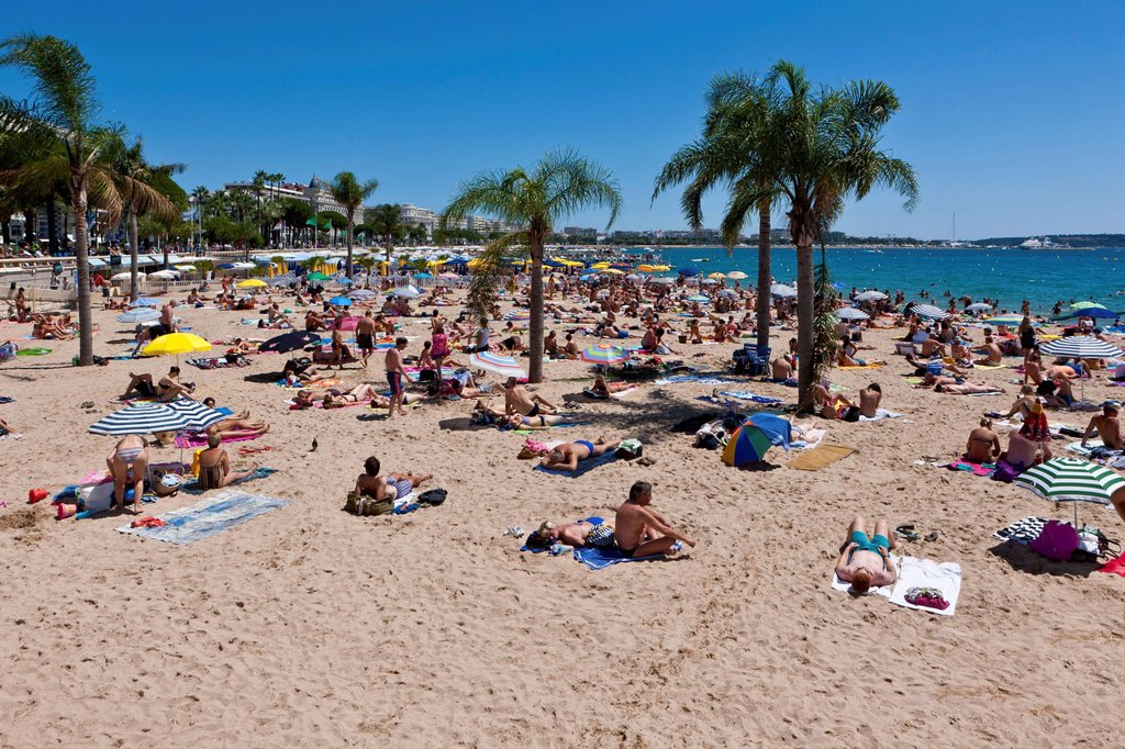 People on the beach of Cannes, at the Croisette, Côte d´Azur, Southern France, Europe, PublicGround : Stock Photo