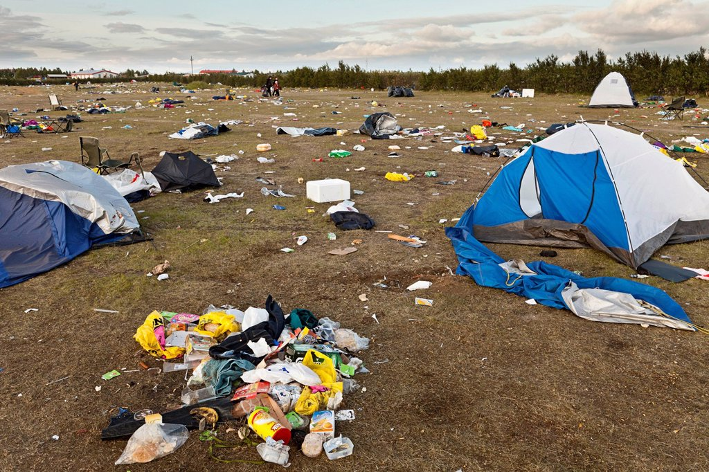 Stock Photo: 1848-710719 Meadow full of garbage, waste, destroyed tents and broken camping equipment after a rock concert for young people on the outskirts of Hella in the south of Iceland, Europe