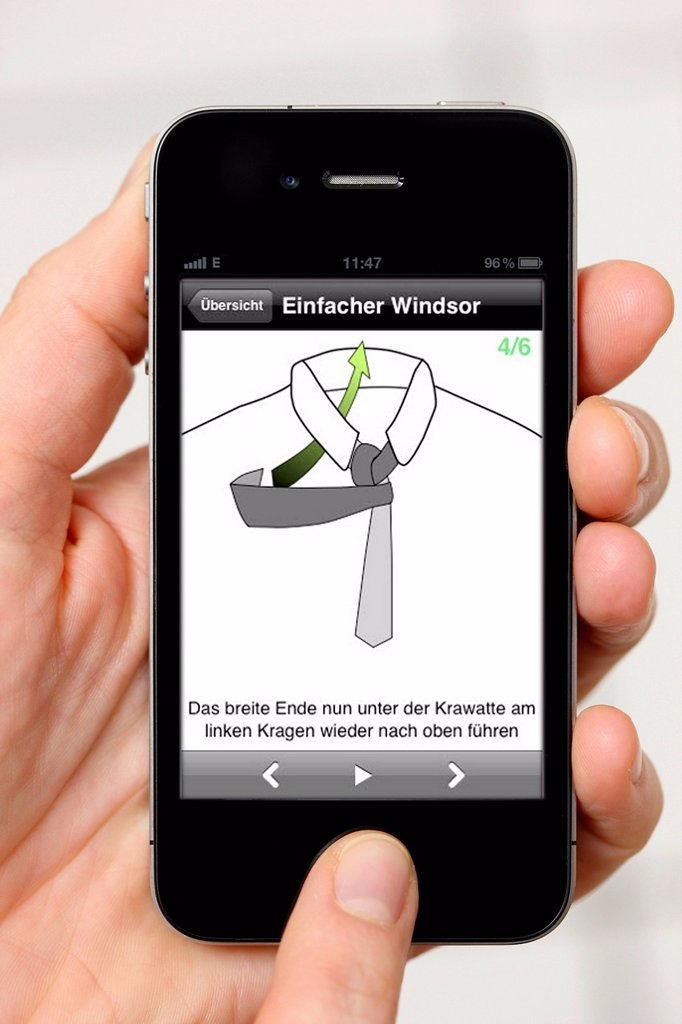 Iphone, smart phone, app on the screen, instructions on how to tie a tie : Stock Photo