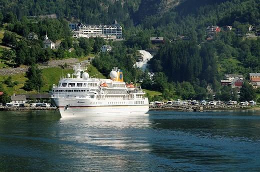 Ferry Geiranger to Hellesylt leaving the village Geiranger, Geiranger fjord, More og Romsdal, Norway, Scandinavia, Europe : Stock Photo