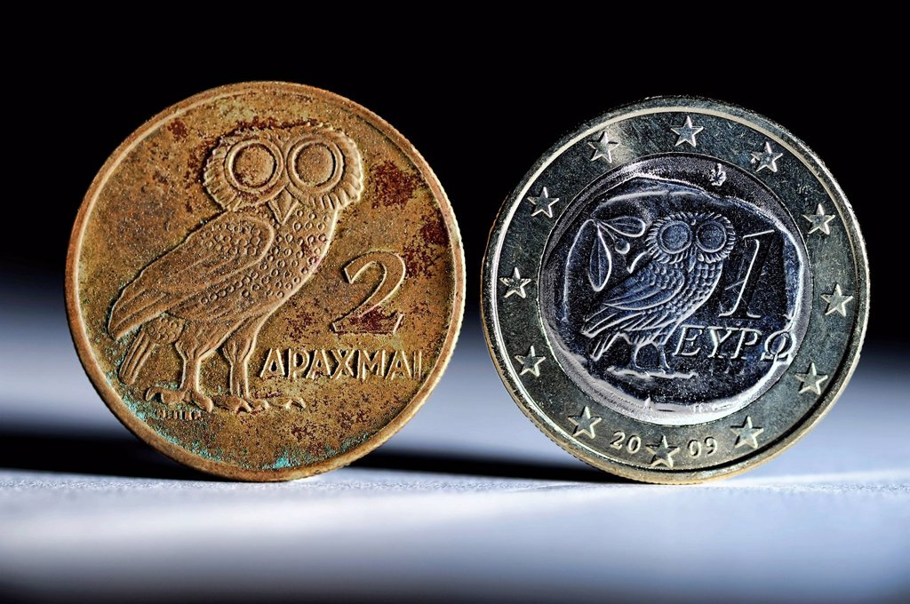 Stock Photo: 1848-712208 Greek drachma and a Greek one_euro coin