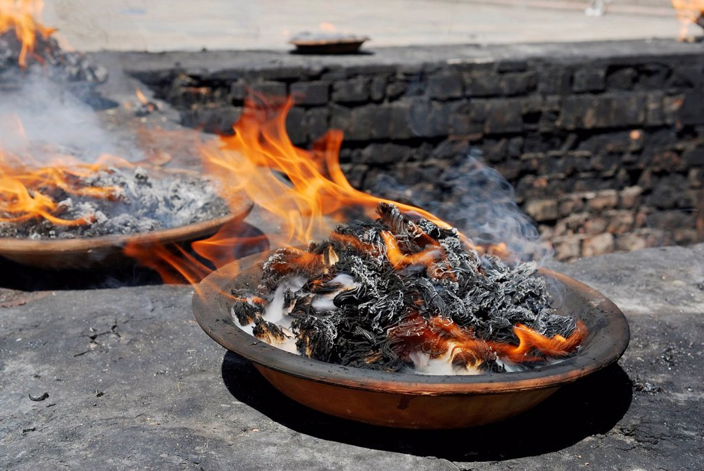 Fire in a dish, Pashupatinath, Kathmandu, Nepal, Asia : Stock Photo
